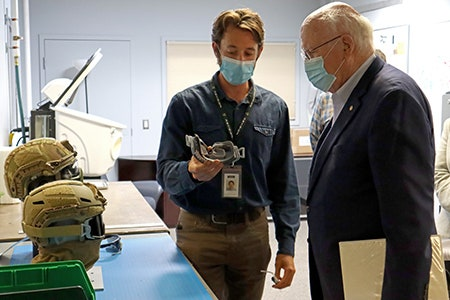 Revision Industrial Designer, Peter Grunwald, shows Senator Patrick Leahy a 3D printed goggle